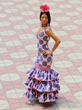 Pink flamenco dress with polka dots. This is a typical Andalusian and Spanish costume. Very used in flamenco folklore and events such as the Seville fair Stock Photos