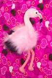 Pink flamingo, soft toy and balloons on a pink background with hearts. The concept of holiday gifts and decorations royalty free stock photos