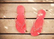 Pink flip flop sandals on wood. Background Royalty Free Stock Photo