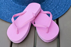 Pink Flip Flops and Blue Straw Hat Stock Photos