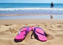 Pink flip flops at a greek beach - greek summer destination Royalty Free Stock Photography