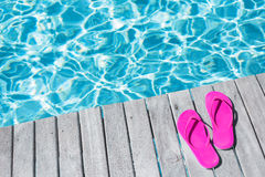 Pink flip flops by the swimming pool Royalty Free Stock Photography