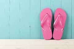 Pink flip flops on wooden background Royalty Free Stock Photo