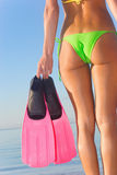 Pink flippers. Beauitful exotic woman holding pink snorkel fins stock images