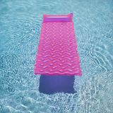 Pink float in swimming pool. Royalty Free Stock Photography