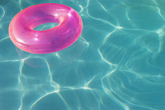 Pink Float Tube Floating On Water Stock Photography