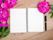 Pink floral assorted pink flower on wooden background with notepad free space, copy space for tekst royalty free stock image