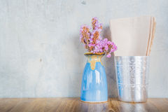 Pink flower in blue vase on a wooden table Royalty Free Stock Image