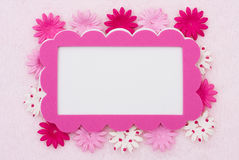 Pink Flower border. A pink flowers making a border on a pink background, pink flower border stock photos