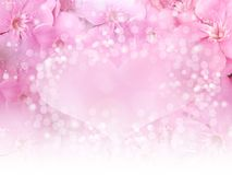 Pink flower border and heart bokeh background for wedding card or valentine concept Stock Images