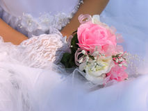 Pink flower bouquet. A flower girl holds her bouquet with gloved hands Stock Photo