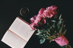 Pink Flower Bouquet Beside Opened Book Stock Image