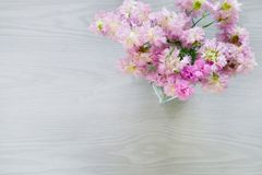 Pink flower bouquet in vase on gray wooden background Stock Photography