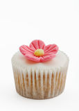 Pink flower cupcake. Isolated on white Royalty Free Stock Photo