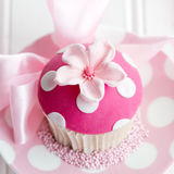 Pink flower cupcake. Cupcake decorated with a pink fondant flower Stock Images