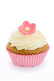 Pink flower cupcake. Pink cupcake isolated against a white background Stock Photos