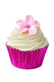 Pink flower cupcake. Isolated against white Royalty Free Stock Photo
