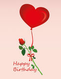 Pink flower hanging on a red ribbon with a bow on a hot air balloons Royalty Free Stock Photo