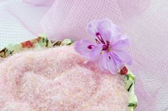 Pink flower with pink bath salt in decoupage decorated  bowl on Royalty Free Stock Images