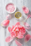 Pink flower salt peony essential oil for spa and aromatherapy Stock Photo