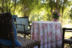 Pink flower, table and chair on terrace Royalty Free Stock Photography