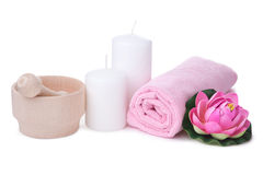 Pink flower and towel with two candles. spa composition Stock Photography