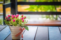 Pink flower vase put on the table Have background blurred Stock Photography