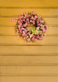 Pink flower wreath decorated for easter with bunny Royalty Free Stock Photos