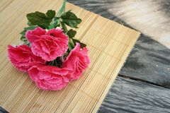 Pink flowers on background of brown wood. Royalty Free Stock Image