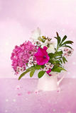 Pink flowers. On pink background in a little vase Stock Photo