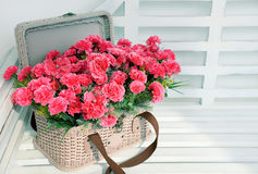 Pink flowers in basket Royalty Free Stock Image