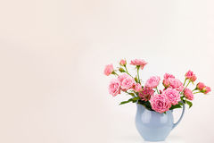 Pink flowers in blue jug. Royalty Free Stock Photo