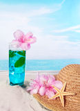 Pink flowers on blue ocean Stock Photos