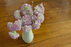 Pink flowers bouquet. Against a wooden background Royalty Free Stock Photos