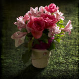 Pink Flowers Bouquet. In vase on a green background with canvas texture Stock Photography