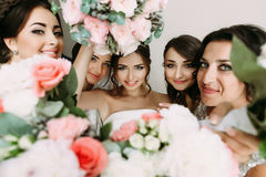 Pink flowers and bride's face in the middle Royalty Free Stock Photo