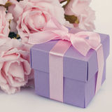 Pink flowers and  gift box Stock Image