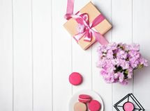 Pink flowers and giftbox with pink ribbon stock images