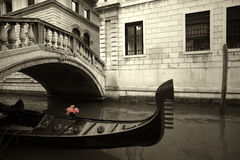 Pink Flowers and gondola. Pink flowers waiting on a rain covered gondola in Venice, Italy stock photos