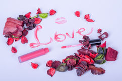 Pink flowers and lipstick kiss on a white background Stock Images