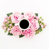 Pink flowers with mug of black coffee drink on white background. Flat lay, Top view. Flowers texture. Pink flowers with mug of black coffee drink on white royalty free stock photos