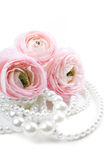 Pink flowers and pearl beads Stock Images