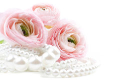 Pink flowers and pearl beads Royalty Free Stock Photography