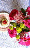 Pink flowers and pistachio muffin. Muffin with pistachio cream and flowers Royalty Free Stock Photography