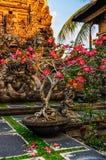 Pink flowers in Saraswati Temple in Ubud, Bali Stock Images
