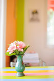 Pink flowers in a vase Stock Images