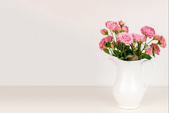 Pink flowers in white jug. Stock Image
