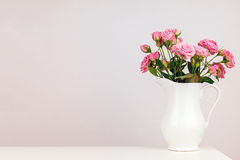Pink flowers in white jug. Royalty Free Stock Photos