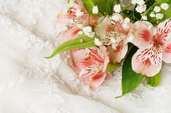 Pink flowers on white lace Stock Photography