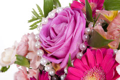 Pink flowers with white pearls Stock Photography
